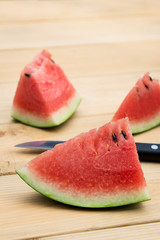 Watermelon slice on wooden table