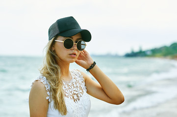 Young girl on vacation .Girl in cap and glasses