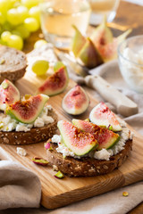 Slices of bread with cheese and fresh figs