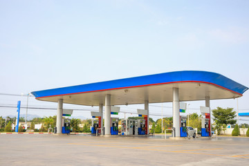 Petrol gas fuel station with clouds and blue sky Wall mural