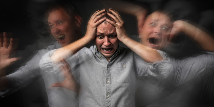 Man having panic attack on dark background