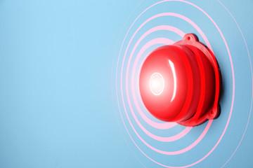 Modern alarm bell on color background