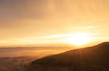 Sunset over village Steinbergen in Germany