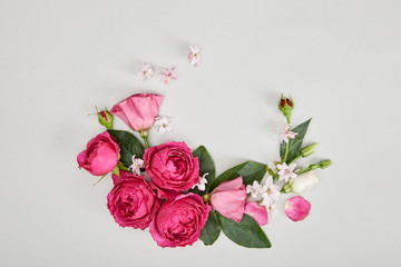 top view of floral composition made of pink roses isolated on white