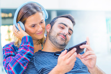 happy couple listeming music with headphone