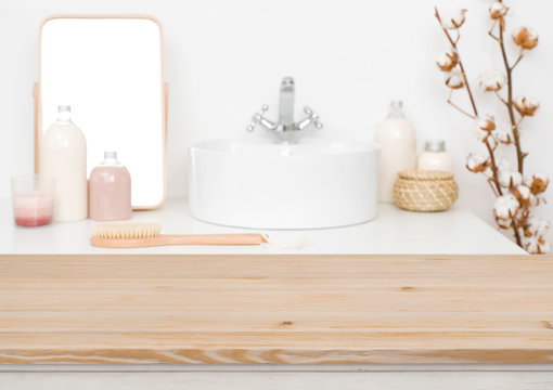 Wooden table top for product display and blurred bathroom background