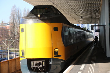 Intercity train ICM Koploper along the platform of railway station Voorburg in the Netherlands