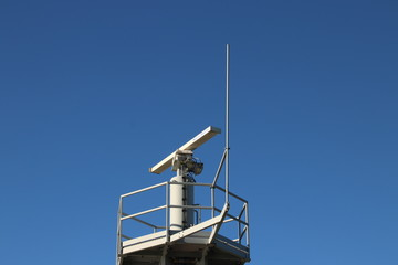 Traffic radar antenna at the harbor of IJmuiden to guide the ships in the Netherlands at the North Sea