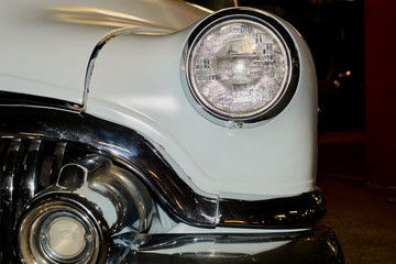 the headlights of an old vintage car