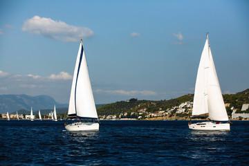 Fototapete - Sailing boats participate in sail yacht regatta around Saronic Islands in Aegean Sea - Greece.