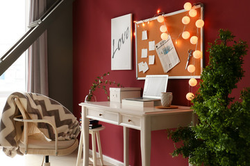 Stylish workplace with laptop in modern room