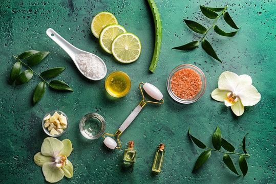 Ingredients for facial mask with massage tool on color background