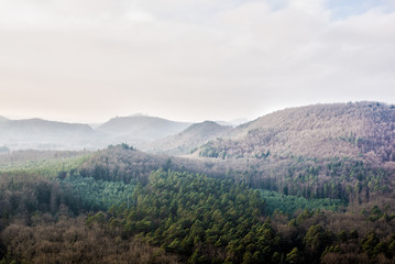 Panoramic view of the mountains against cloudy blue sky on a sunny winter day. Parc Naturel Régional des Vosges du Nord. France, Lorraine