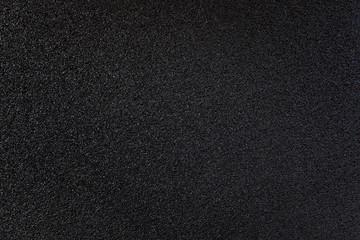 Black new fresh asphalt on road background