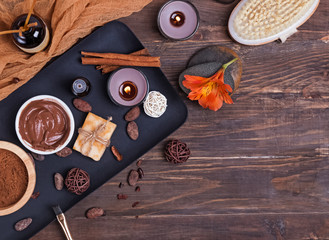 Chocolate spa set on the wooden background, top view.