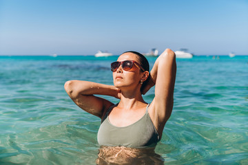 Pretty pan asian girl relaxing in blue sea water.