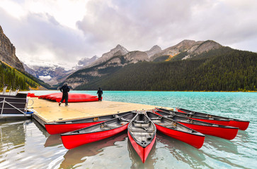 Wall Mural - Canoeing at Lake Louise, one of the most beautiful alpine lakes in the Canadian Rockies,Canada
