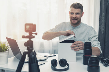 social media technology influencer recording unboxing video at home