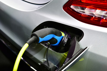 Wall Mural - Electric car on charging, close up