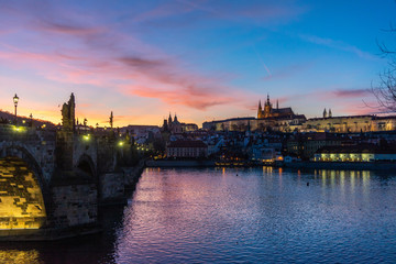 View on Charles bridge and Prague castle in Prague, Czech Republic, at sunset. Beautiful travel background