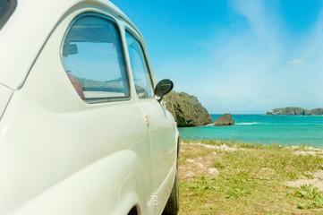 Retro car with ocean view