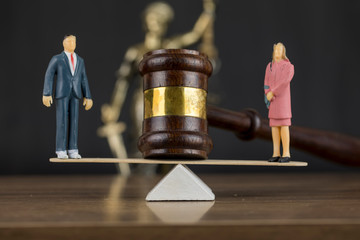 Divorce Concept , Gavel , Seesaw Scales , Woman and Man