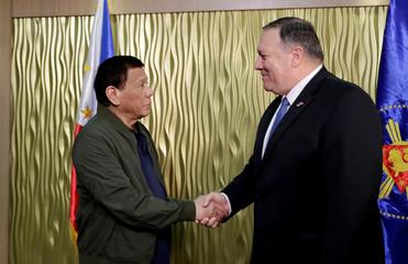 Philippine President Rodrigo Duterte and U.S. State Secretary Mike Pompeo shake hands at Villamor Air Base in Pasay City