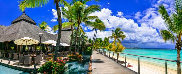 Wall Mural - Relaxing  bar in palm shade and pool bnear the beach. tropical paradise Mauritius island