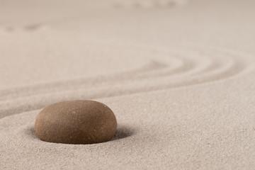 Foto op Plexiglas Stenen in het Zand Concentration trough focus on a zen meditation stone. Round rock in sand texture background. Concept for yoga or spa welness treatment.