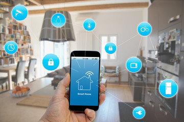 Smart Home concept, Hand holding smartphone with smart home application on screen Fotoväggar