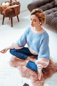 Top view of an attractive relaxed woman meditating