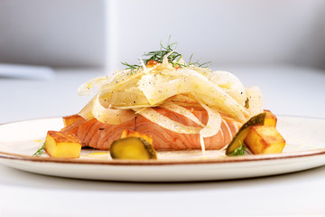 Salmon fillet with salad of fennel on resturant