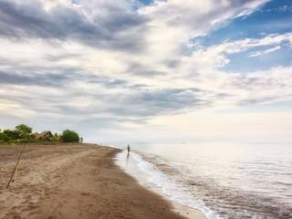a dark sand beach in northern Bali Indonesia