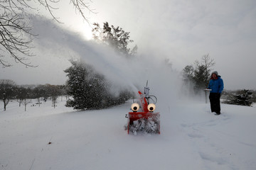 """MIT research engineer Dane Kouttron operates """"Chomper,"""" a semi-autonomous, GPS-guided snow blower, in Cambridge"""