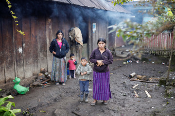Catarina Alonzo, mother of Felipe Gomez Alonzo, a 8-year-old boy who fell ill and died in the custody of U.S. Customs and Border Protection, stands outside her home in the village of Yalambojoch