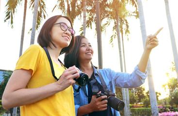 Portrait two tourist asian women in the park