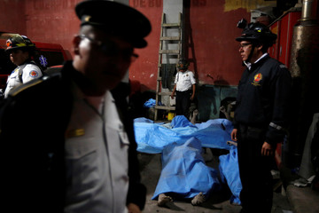 The ash covered bodies of victims of Fuego volcano's eruption are seen inside the morgue in San Juan Alotenango