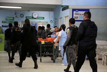 Police officers stand guard inside of Roosevelt Hospital after suspected gang members attacked it, in Guatemala City