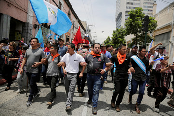 Anti-government protesters march in Guatemala City