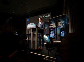 Canadian Prime Minister Justin Trudeau makes an announcement at the Canadian Space Agency in Longueuil
