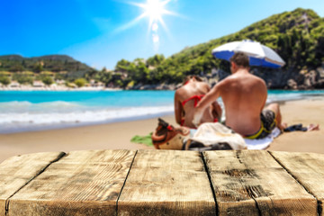 Desk of free space for your decoration. Beach landscape with two lovers on sand. Summer time.