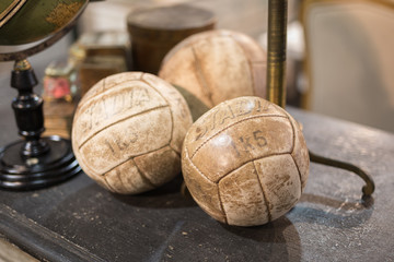 White Vintage Leather  Soccer Balls On Wooden Table