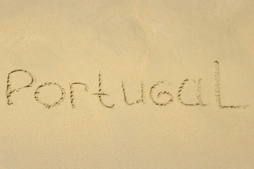 Inscription on wet sand Portugal.