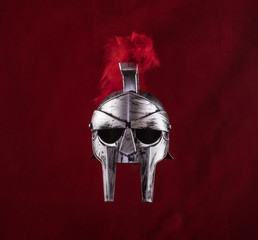 spartan helmet on a red background