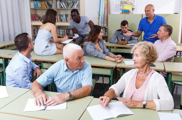 Mature man and woman talking during exam