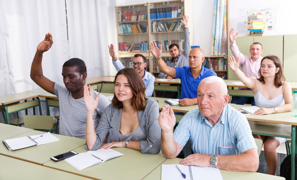 Group  different ages asks questions during exam