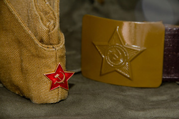 Part of the uniform of the Soviet soldier: forage-cap, tunic, soldier's belt.