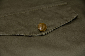 Pocket on the tunic of a Soviet soldier with a star on the button.