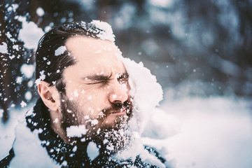 man gets a snowball in the face