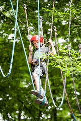 Young teenage boy in a rope park